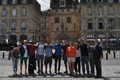 A group of students on a walking tour of Bordeaux
