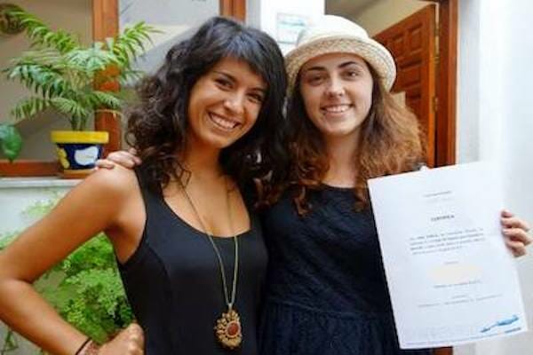 Student and teacher with a certificate