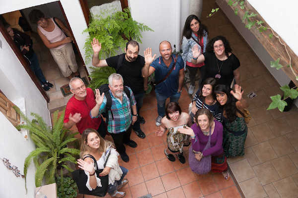 Students waving from the courtyard in Granada language school