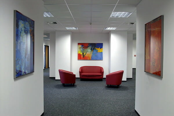 Red sofas in corridor outside classrooms
